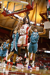 18 November 2007: Dinma Odiakosa gets past Todd Hendley and Vladimir Kuljanin for a lay up. Illinois State Redbirds defeated the Seahawks of the University of North Carolina - Wilmington 89-73 on Doug Collins Court in Redbird Arena on the campus of Illinois State University in Normal Illinois.