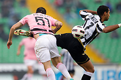 Benatia Al Mouttaqui Medhi (R) of Udinese vs Pinilla Mauricio Ricardo Ferrera of Palermo vs  during football match between Udinese Calcio and Palermo in 8th Round of Italian Seria A league, on October 24, 2010 at Stadium Friuli, Udine, Italy.  Udinese defeated Palermo 2 - 1. (Photo By Vid Ponikvar / Sportida.com)
