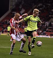 Photo: Mark Stephenson/Sportsbeat Images.<br /> Stoke City v Sheffield United. Coca Cola Championship. 10/11/2007.Sheffield's David Carney  (R) holds off Stokes Andy Wilkinson