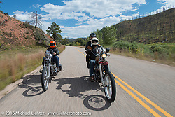 Bill Buckingham (L) riding his 1936 Harley-Davidson Knucklehead custom chopper (that won top honors at Born Free 6) with his good friend Sean Duggan on his 1936 Harley-Davidson Knucklehead chopper through areas of the devastating Hayman Fire west of Colorado Springs during Stage 9 (249 miles) of the Motorcycle Cannonball Cross-Country Endurance Run, which on this day ran from Burlington to Golden, CO., USA. Sunday, September 14, 2014.  Photography ©2014 Michael Lichter.