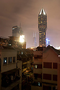Shanghai night skyline scene, China. Tomorrow Square which also contains the Marriot hotel stands on the edge of People's Square in downtown Shanghai.