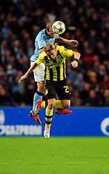 Manchester City's Pablo Zabaleta battles for the high ball with Borussia Dortmund's Marcel Schmelzer - Photo mandatory by-line: Joe Meredith/JMP  - Tel: Mobile:07966 386802 03/10/2012 - Manchester City v Borussia Dortmund - SPORT - FOOTBALL - Champions League -  Manchester   - Etihad Stadium -