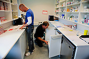 The medical personnel is preparing medicinal doses used by a number of inmates under treatment inside the luxurious Halden Fengsel, (prison) near Oslo, Norway.