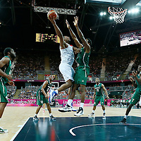 06 August 2012: France Boris Diaw goes for the skyhook over Nigeria Al-Farouq Aminu during 79-73 Team France victory over Team Nigeria, during the men's basketball preliminary, at the Basketball Arena, in London, Great Britain.