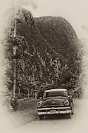 Car and mogote, San Vicente, near Vinales, Pinar del Rio, Cuba.