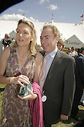 Lord and Lady Andrew Lloyd Webber, Cartier International Polo. Guards Polo Club. Windsor Great Park. 30 July 2006. ONE TIME USE ONLY - DO NOT ARCHIVE  © Copyright Photograph by Dafydd Jones 66 Stockwell Park Rd. London SW9 0DA Tel 020 7733 0108 www.dafjones.com