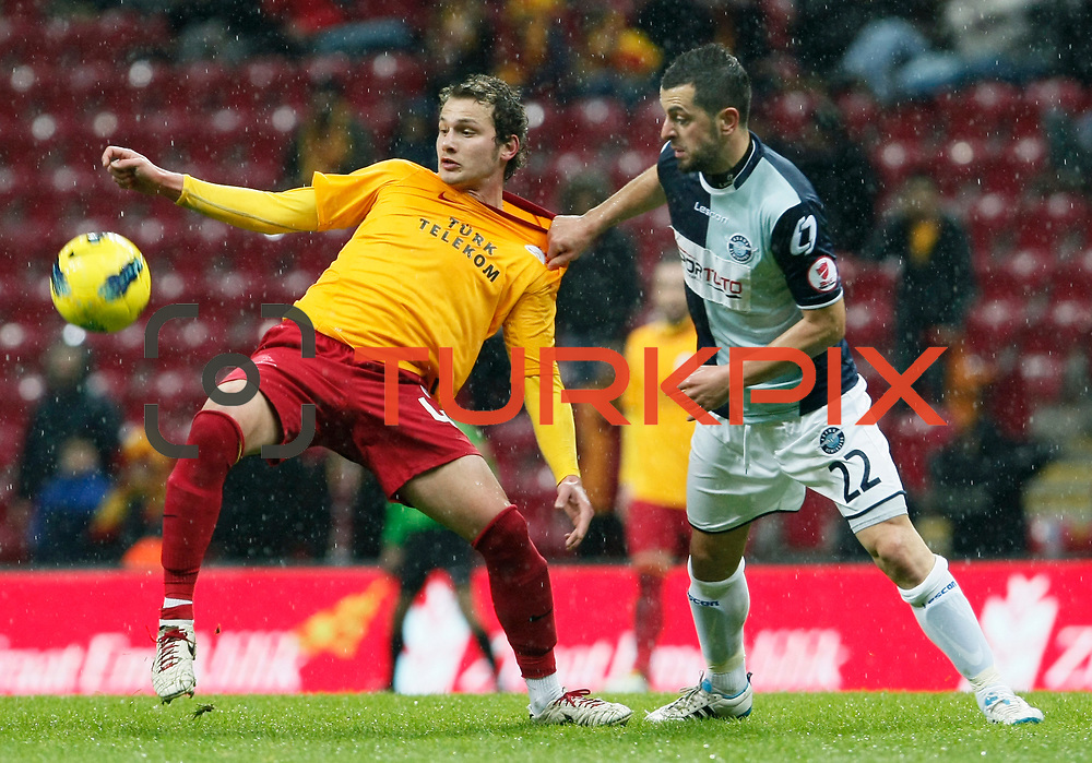 Galatasaray's Mertan Caner Ozturk (L) and AdanaDemirspor's Burak Keskin (R) during their Turkey Cup matchday 3 soccer match Galatasaray between AdanaDemirspor at the Turk Telekom Arena at Aslantepe in Istanbul Turkey on Tuesday 10 January 2012. Photo by TURKPIX