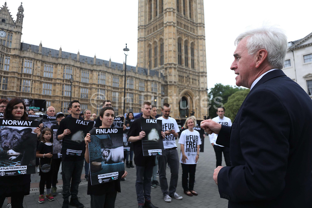 Pro fur ban campaigners outside Parliament June 4th 2018, Central London, United Kingdom.  John McDonnell, Shadow Chancellor speaks in support of the ban and the protest. In connection with a debate on banning fur import to Britain in Parliament Open Cage and Humane Society International held a demonstration outside Parliament to draw attention to the continued use of fur in Britain inspite of fur production is banned in Britain. The campaigners want all sale of fur banned.