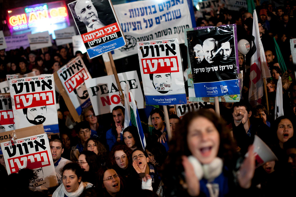 Israelis carry banners with the image of Israel's Foreign Minister Avigdor Liebrman during a demonstration against racism in Zion Square in Jerusalem on February 26, 2011.