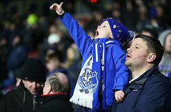"""A young Everton fan in the stands shows his support during the Premier League match at the John Smith's Stadium, Huddersfield. PRESS ASSOCIATION Photo. Picture date: Tuesday January 29, 2019. See PA story SOCCER Huddersfield. Photo credit should read: Nigel French/PA Wire. RESTRICTIONS: EDITORIAL USE ONLY No use with unauthorised audio, video, data, fixture lists, club/league logos or """"live"""" services. Online in-match use limited to 120 images, no video emulation. No use in betting, games or single club/league/player publications"""