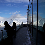 Tourists view the snow capped mountains around Queenstown from the Skyline Gondola after the biggest snow storm in New Zealand in the past 50 years. Queenstown, New Zealand, 16th August 2011. Photo Tim Clayton