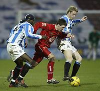 Fotball<br /> England 2004/2005<br /> Foto: SBI/Digitalsport<br /> NORWAY ONLY<br /> <br /> Coca-Cola League 1<br /> 03/01/2005.<br /> <br /> Huddersfield v Bristol City<br /> <br /> Bristol's Paul Heffernan tries to break past Huddersfield's Efe Sodje and John Worthington