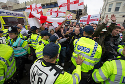 © Licensed to London News Pictures . 27/04/2014 . Brighton , UK . Nationalist group March for England march in Brighton , timed to coincide with St George's Day. The annual event has resulted in open fighting between anti-fascist groups and right wing nationalists and injuries to police trying to separate opposing groups . Sussex Police reports their operation to manage the event costs £500,000 . Photo credit : Joel Goodman/LNP