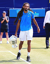 Dustin Brown of Germany carries the trophy after winning the AEGON Manchester Trophy Mens Final against Yen-Hsun Lu of Chinese Taipei  - Mandatory by-line: Matt McNulty/JMP - 05/06/2016 - TENNIS - Northern Tennis Club - Manchester, United Kingdom - AEGON Manchester Trophy