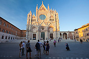 Tourists visit Il Duomo di Siena, the Cathedral of Siena, Italy.
