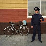 DONETSK, UKRAINE - April 17, 2014: A Ukrainian policeman takes guard at a pro-Ukraine rally in central Donetsk.