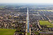 Nederland, Overijssel, Dedemsvaart, 01-05-2013; overzicht vanuit het Westen met<br /> zicht op de Hoofdvaart (water deels gedempd). Voormalige veenkolonie.<br /> Main canal of former peatland 'colony'.<br /> luchtfoto (toeslag op standard tarieven);<br /> aerial photo (additional fee required);<br /> copyright foto/photo Siebe Swart