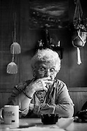 """Helen """"Granny"""" Firstine smokes and has coffee as she visits with other patrons at Town Cafe in Edgar Springs, Missouri. The U.S. Census Bureau named Edgar Springs the population center of the United States."""