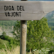 LONGARONE, ITALY - SEPTEMBER 26:  A sign pointing towards the Vajont Damn is seen on  September 26, 2013 in Longarone, Italy. The Vajont  tragedy happened on the night of the 9th October 1963, when a landslide broke away from Mount Toc and fell into the Vajont river causing a wave that struck the neighboring towns, the devastation was total, more than 2000 people died and only few lucky villagers survived.  (Photo by Marco Secchi/Getty Images)