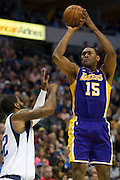 Metta World Peace (15) of the Los Angeles Lakers takes a shot on goal over O.J. Mayo (32) of the Dallas Mavericks at the American Airlines Center in Dallas on Sunday, February 24, 2013. (Cooper Neill/The Dallas Morning News)