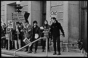 Madison, WI - March 1970. On March 15, 1970, the University of Wisconsin - Madison Teaching Assistants' Association voted to strike, and the campus was filled with picket lines as well as demonstrations of related and other issues. The strike lasted until early April, when the Association and University came to an agreement. Protesters carry Cuban flags, and signs in support of Che Guevara and Black Panther Ericka Huggins near Birge Hall.