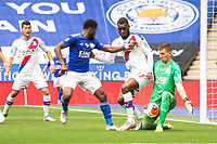 LEICESTER, ENGLAND - JULY 04: Crystal Palace goalkeeper Vicente Guaita makes a save from Kelechi Iheanacho of Leicester City during the Premier League match between Leicester City and Crystal Palace at The King Power Stadium on July 4, 2020 in Leicester, United Kingdom. Football Stadiums around Europe remain empty due to the Coronavirus Pandemic as Government social distancing laws prohibit fans inside venues resulting in all fixtures being played behind closed doors. (Photo by MB Media)