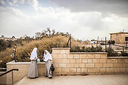 Two nuns are seen at the Quaser El yahud baptism site before, heading to the Jordan river bank to preform a baptism ceremony.