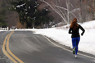 POCATELLO, N.Y. - A female runner warms up for the Jingle Jog road race in Pocatello, N.Y., on Dec. 11, 2005.