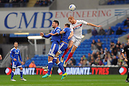 Cardiff City's Sean Morrison (4) and Joe Ralls (c) are challenged for a header by Wigan's Shaun MacDonald (r). EFL Skybet championship match, Cardiff city v Wigan Athletic at the Cardiff city stadium in Cardiff, South Wales on Saturday 29th October 2016.<br /> pic by Carl Robertson, Andrew Orchard sports photography.
