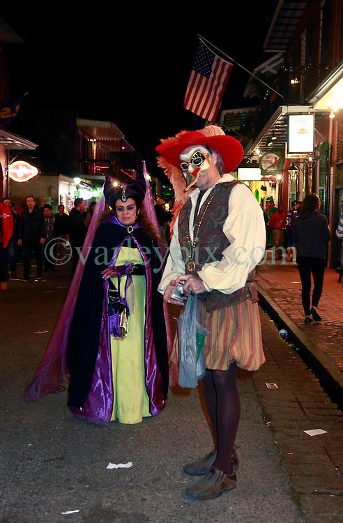 03 Feb 2013. New Orleans, Louisiana USA. .Bourbon Street. .A couple walk the street dressed in costume..Photo; Charlie Varley