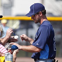 February 18, 2011; Port Charlotte, FL, USA; Tampa Bay Rays catcher John Jaso (28) hangs around to sign autographs for fans following a spring training practice at Charlotte Sports Park.  Mandatory Credit: Derick E. Hingle