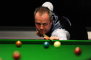 John Higgins of Scotland during his match against England's Mark King.  Bet Victor Welsh open snooker at the Newport centre in Newport, South Wales on Wed 26th Feb 2014.<br /> pic by Andrew Orchard, Andrew Orchard sports photography.