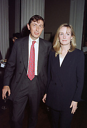 The HON.ADAM & MRS MACMILLAN at a party in London on October 23rd 1996.LSY 28