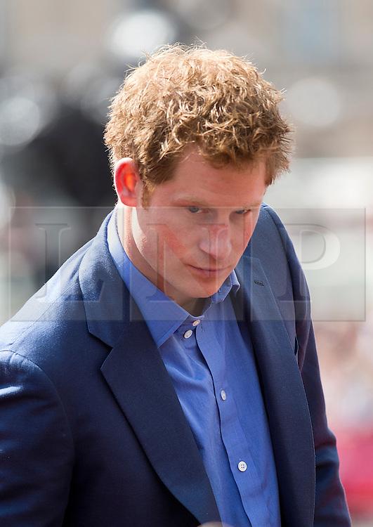 © London News Pictures. 22/04/2012. London, UK. HRH Prince Harry during a winners medal presentation at the 2012 Virgin London Marathon on April 22, 2012. Photo credit : Ben Cawthra /LNP