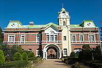 The first full scale winery in Japan, Chateau Kamiya, was built in 1903 by Denbei Kamiya. The main building is of French-style masonry architecture with a reddish-brown wall, green roof and a white clock. Denbei Kamiya, went to France in the late 1800s to undergo training and acquired techniques in wine production in hopes of introducing wine to the Japanese, returning to his country to established its first winery. .