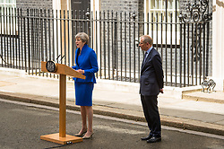 Prime Minister Theresa May, accompanied by her husband Philip, makes a statement in Downing Street after she traveled to Buckingham Palace for an audience with Queen Elizabeth II following the General Election results.