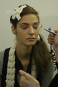 Backstage before the Chanel couture fashion show. Grand Palais, Ave Winston Churchill. Paris. 24  January  2006.  ONE TIME USE ONLY - DO NOT ARCHIVE  © Copyright Photograph by Dafydd Jones 66 Stockwell Park Rd. London SW9 0DA Tel 020 7733 0108 www.dafjones.com