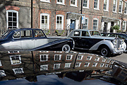 A 1964 Empress Bentley and a 1954 Rolls-Royce Silver Dawn are parked in Smith Square, a small square behind the Houses of Parliament, before collecting their VIP passengers - barristers who are being sworn in as QCs (aka Silks in legal vernacular), on 11th March 2019, in London, England.