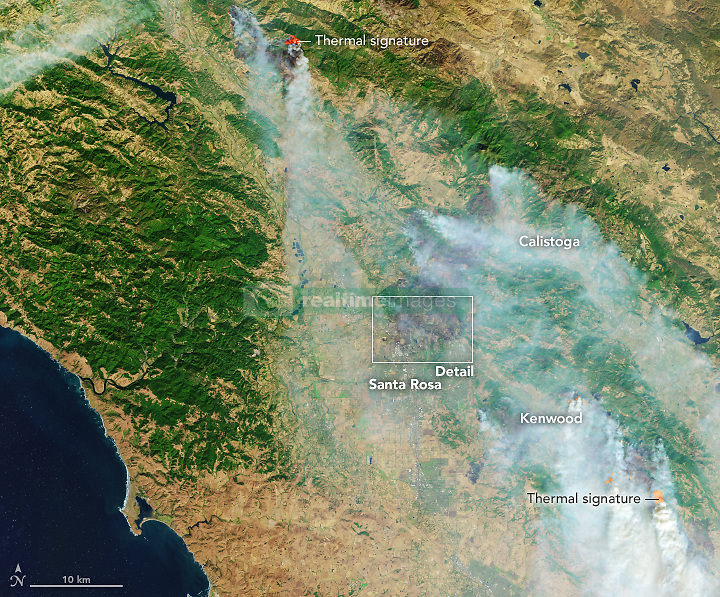 """October 9, 2017 - Santa Rose, California, U.S. - Parts of northern California have been ravaged by intense and fast-burning wildfires that broke out on October 8, 2017. Blazes that started on a few hundred acres around Napa Valley were fanned by strong northeasterly winds, and by October 10, the 14 fires had consumed as much as 100,000 acres (150 square miles) of land. States of emergency have been declared in Napa, Sonoma, Yuba, and Mendocino counties, and thousands of people were asked to evacuate. The densely populated """"wine country"""" is famous for its vineyards and wine-making operations and the tourists they attract. In the late morning of October 9, the Moderate Resolution Imaging Spectroradiometer (MODIS) on NASA's Terra satellite acquired a natural-color image (top) of the smoke billowing from the fires. About two hours later, the MODIS instrument on NASA's Aqua satellite captured the second view. (Credit Image: © NASA Earth/ZUMA Wire/ZUMAPRESS.com)"""