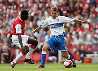 Photo: Chris Ratcliffe.<br />Arsenal v Middlesbrough. The Barclays Premiership. 09/09/2006.<br />James Morrison (R) of Middlesbrough clashes with Kolo Toure of Arsenal.
