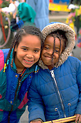 Friends age 9 smiling at May Day Heart of Beast Festival and Parade.  Minneapolis  Minnesota USA