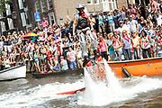 Canal Parade 2013 in de Amsterdamse grachten. De Canal Parade is het hoogtepunt van de Gay Pride, een feestweek met voornamelijk homo's, bi's, lesbiennes en transgenders.<br /> <br /> Canal Parade 2013 in the canals of Amsterdam. The Canal Parade is the highlight of the Gay Pride, a festival week with mostly gay, bisexual, lesbian and transgender people.<br /> <br /> Op de foto / On the photo: <br /> <br />  Jets in de kanalen / Jets in the canals