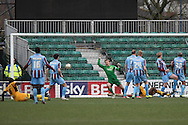 Chris Zebroski of Newport (grounded, right) scores his side's second goal. Skybet football league 2 match, Newport county v Scunthorpe Utd at Rodney Parade in Newport, South Wales on Saturday 1st March 2014.<br /> pic by Mark Hawkins, Andrew Orchard sports photography.