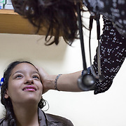CAPTION: Though 13-year-old Heiden Guitierrez stays just an hour and a half away from Hospital Escuela, her cleft palate was operated on elsewhere. However, this hospital offers her periodic check-ups. Dr Gonzalez says that his team plans to perform a Furlow lengthening palate repair, in which they will transpose the muscles so that they will function better, ensuring that Heiden's voice will sound less nasal. Tragically, she dropped out of school because she could not take the bullying and teasing of other kids. After the operation, the doctors hope that Heiden will ultimately go back to school with her head held high. LOCATION: Hospital Escuela, Tegucigalpa, Honduras. INDIVIDUAL(S) PHOTOGRAPHED: Heiden Gutierrez Rios (below) and Dr Gloria Baleska Caderes Estrada (above).