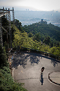 Cyclists turns a corner on steep climb to Tididabo, Barcelona,