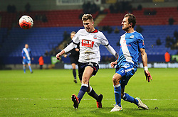 Eastleigh's Jack Midson crosses under pressure from Josh Vela of Bolton Wanderers - Mandatory byline: Matt McNulty/JMP - 19/01/2016 - FOOTBALL - Macron Stadium - Bolton, England - Bolton Wanderers v Eastleigh - FA Cup Third Round