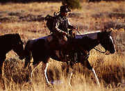Mark Fisher with horses returning from successful elk hunt, Big Wood River, Sawtooth National Recreation Area, Sawtooth National Forest, Idaho.