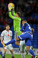 M K Dons goalkeeper David Martin  beats Cardiff City's Kenneth Zohore to the ball.  Skybet football league championship match, Cardiff city v MK Dons at the Cardiff city stadium in Cardiff, South Wales on Saturday 6th February 2016.<br /> pic by Carl Robertson, Andrew Orchard sports photography.
