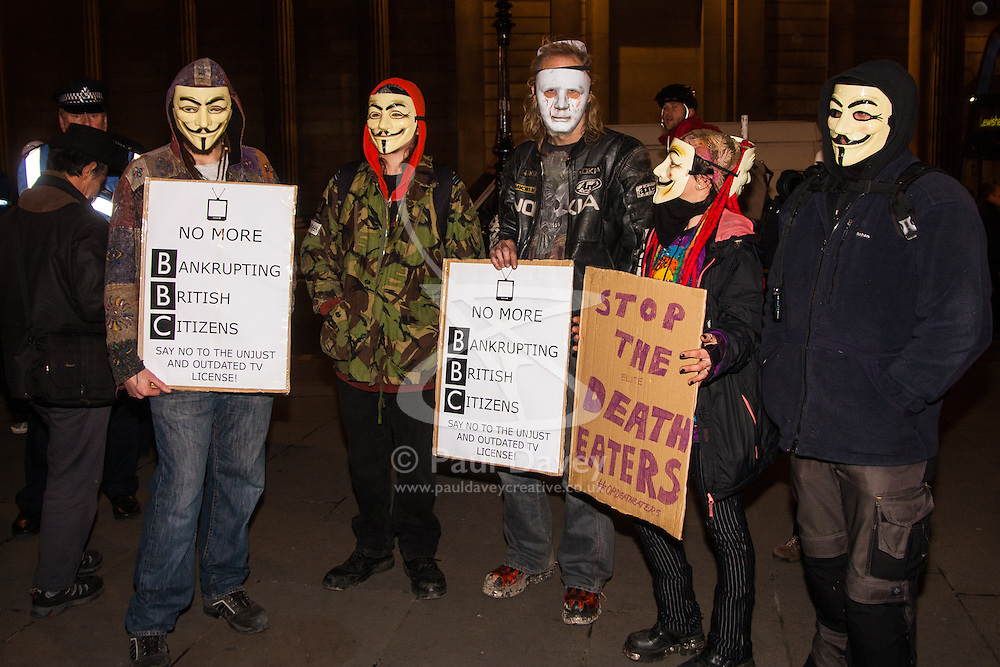 """London, December 23rd 2014. Online activism group Anonymous march through London from the City to the BBC's HQ on Great Portland Street in protest against alleged biases and coverups of a """"paedophile ring"""". PICTURED: Protesters await the beginning of their march outside the Royal Exchange"""