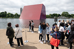 © Licensed to London News Pictures. 18/06/2018. London, UK. The floating installation titled The Mastaba by artist Christo in The Serpentine lake at a photocall. Photo credit: Ray Tang/LNP